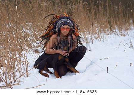 Girl in native american headdress with Doberman Pinscher poster