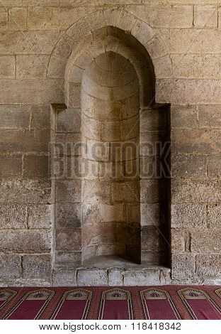 A Stone Wall With Embedded Niche