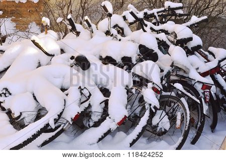 Bikes Covered With A Blanket Of Snow, Winter In Finland