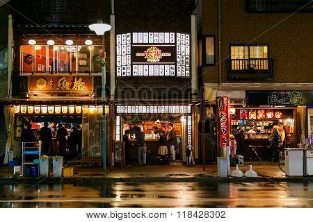 NAGOYA JAPAN - NOVEMBER 18 2015: NIghtlife of Japanese restaurants on the side of a street in Ngoya city