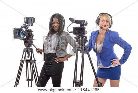 Two Beautiful Young Women With A Professional Video Camera