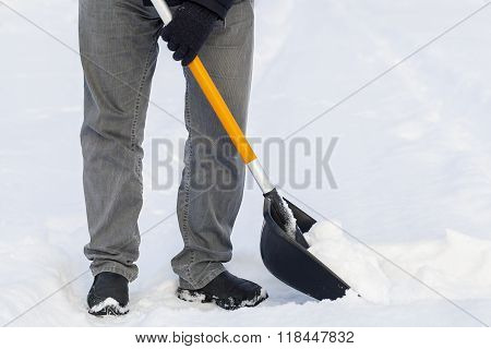 Man using snow shovel in winter