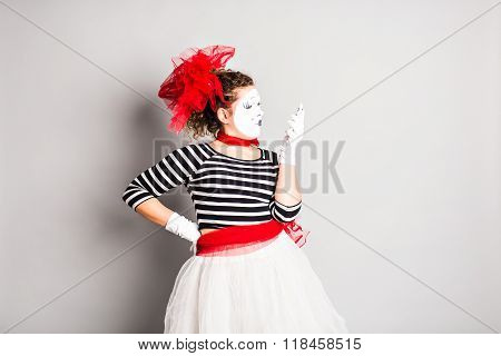 mime with smartphone. Concept of  April Fools Day.
