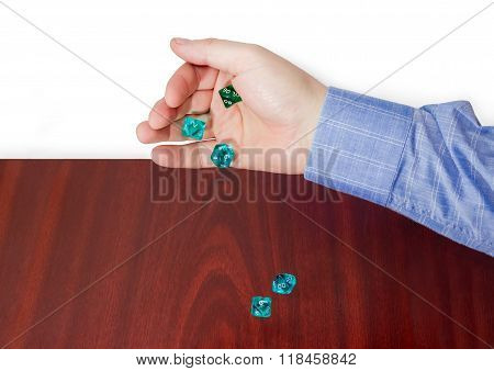 Specialized Polyhedral Dice Thrown From Male Hand On Wooden Surface