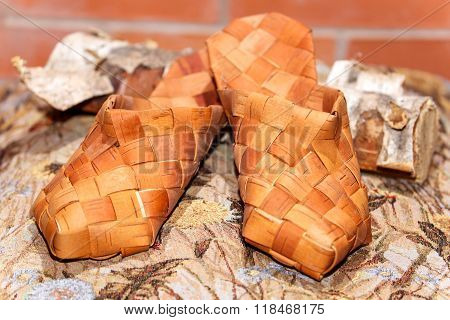 Pair Of Russian Bast Shoes On Birch Log