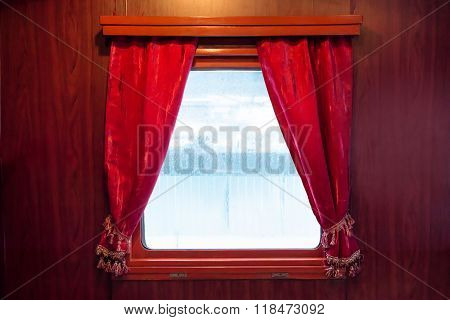 Red Curtains On The Window