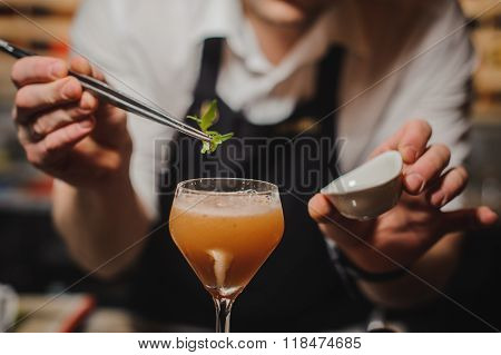 Barman Is Decorating Cocktail With Rocket