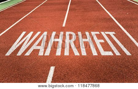 Truth (in German) written on running track