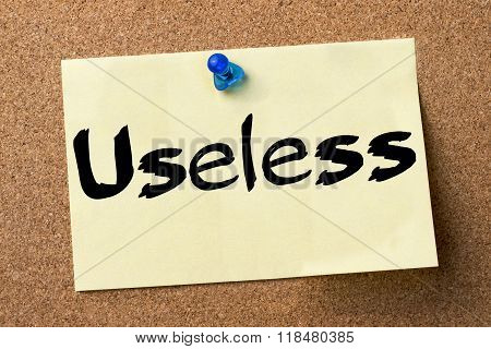 Useless - Adhesive Label Pinned On Bulletin Board