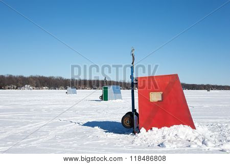 Colorful Ice Shanties On A Frozen Lake