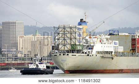 Tugboat Sandra Hugh Assisting Matson Cargo Ship Maui To Maneuver Into The Port Of Oakland