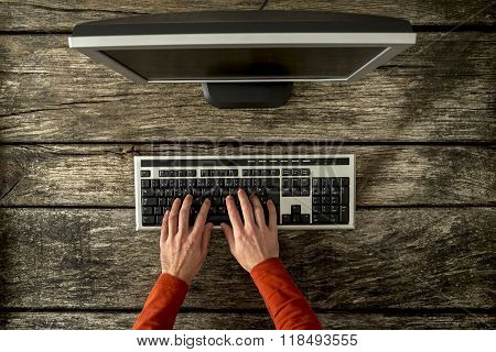 Top View Of Male Hands Typing On Personal Computer Keyboard