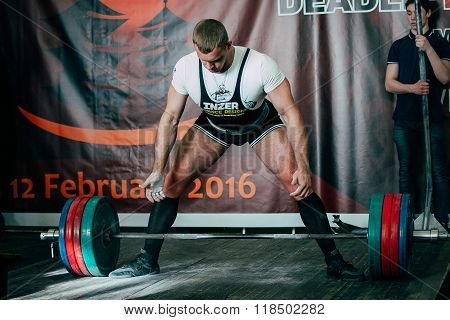final attempt young man athlete performs deadlift barbell