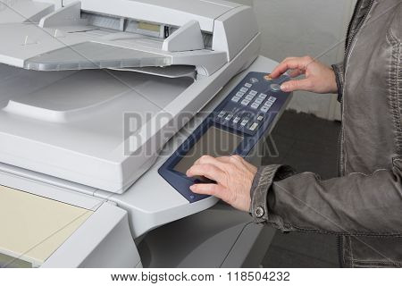 Woman's Hand With A Working Copier At Work