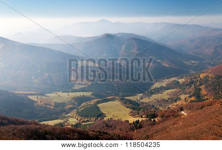Autumnal view from mount Klak to Strazovske vrchy with blue horizons Carpathian mountains Slovakia poster
