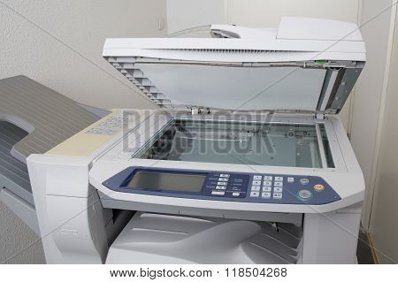 Office Copying Machine Under Thew White Background