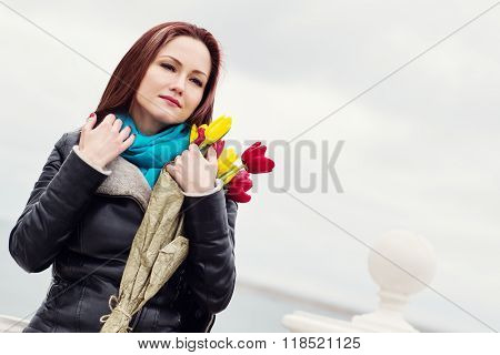 Beautiful Happy Woman With Tulips