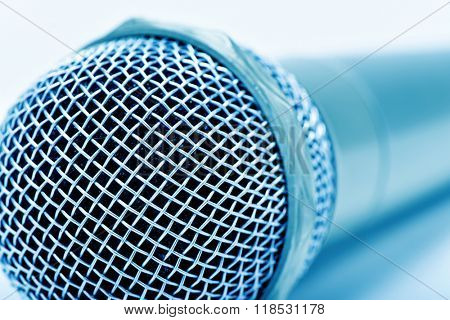 closeup of a microphone, in a blue toning