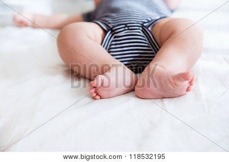 Close-up Legs Of A Newborn Baby