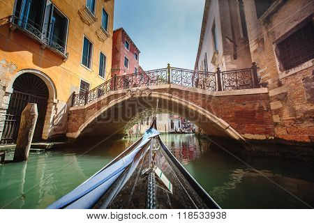 View From Gondola During The Ride Through The Canals Of Venice In Italy