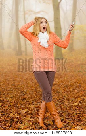 Woman With Earphones Listening To Terrible Music.