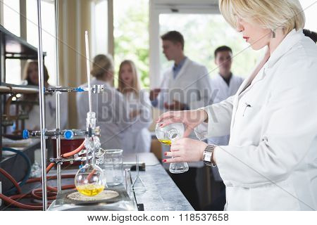 Young beautiful blonde woman researcher chemist preparing substances for chemical use in laboratory
