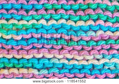 Homemade knitted dishcloth made with multi color cotton yarn.