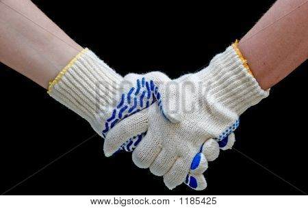 Labor Handshake With Safety Gloves Isolated On Black