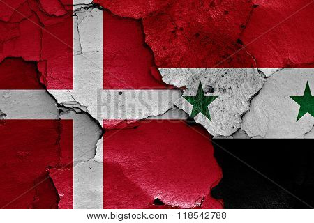 Flags Of Denmark And Syria Painted On Cracked Wall