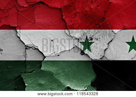 Flags Of Hungary And Syria Painted On Cracked Wall