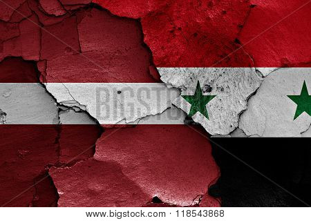 Flags Of Latvia And Syria Painted On Cracked Wall