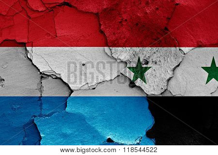 Flags Of Luxembourg And Syria Painted On Cracked Wall