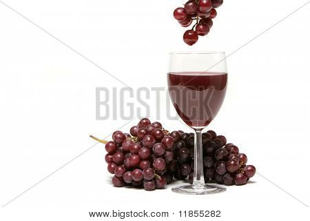 Red grapes dipped into red wine