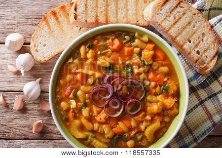 Tuscan ribollita soup close up in a bowl on the table. horizontal view from above poster