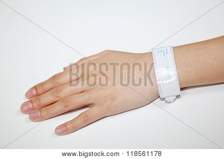 hand with patient identification bracelet