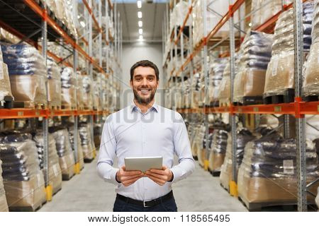 wholesale, logistic, business, export and people concept - happy man or manager with tablet pc computer at warehouse