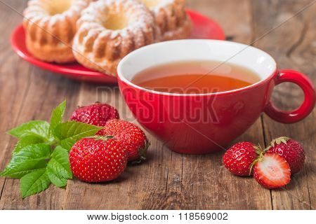 Black English Tea In Red Cup With Strawberry