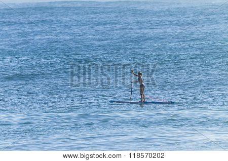 Girl Paddling Board Ocean