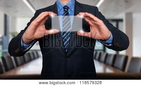 Businessman With Digital Business Card And Copy Space