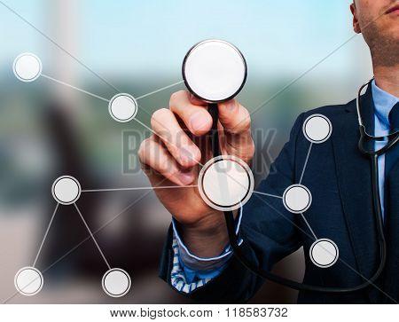 Businessman Using Stethoscope To Diagnose Business Performance Diagram
