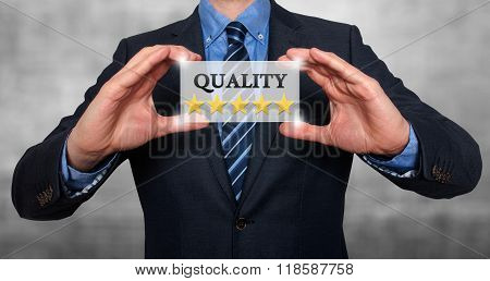 Businessman Holding White Card With Quality Five Stars Sign, Grey - Stock Photo