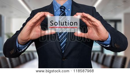 Businessman Holding White Card With Solution Sign, Office - Stock Photo