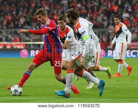 MUNICH, GERMANY - MARCH 11 2015: Bayern Munich's forward Thomas Muller runs with the ball at the Shakhtar defence during the UEFA Champions League match between Bayern Munich and FC Shakhtar Donetsk.