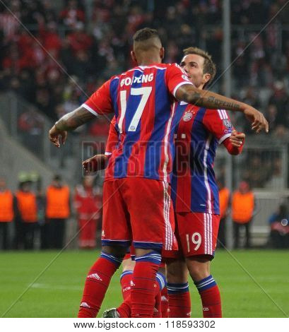 MUNICH, GERMANY - MARCH 11 2015: Bayern Munich's midfielder Mario Gotze celebrates scoring a goal with Bayern Munich's defender Jerome Boateng  during the UEFA Champions League match
