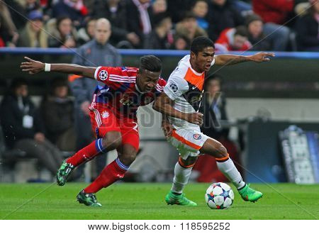 MUNICH, GERMANY - MARCH 11 2015: Bayern Munich's defender David Alaba  and Shaktar's midfielder Douglas Costa compete for the ball during the UEFA Champions League match