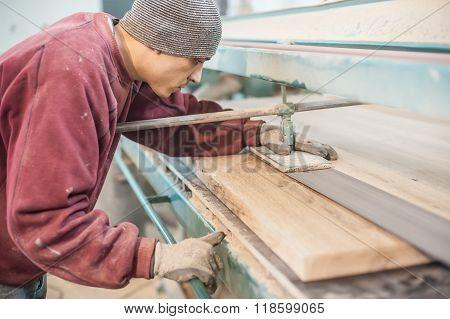 Carpenter using belt sander