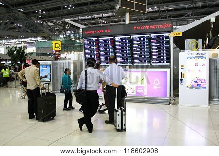 Bangkok - February 17: Travellers View A Departures Board At Suvarnabhumi International Airport On F