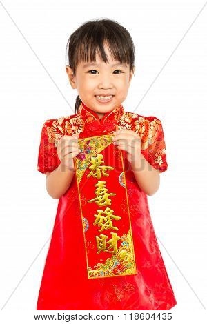 Asian Little Girl Holding Red Couplets For Chinese New Year