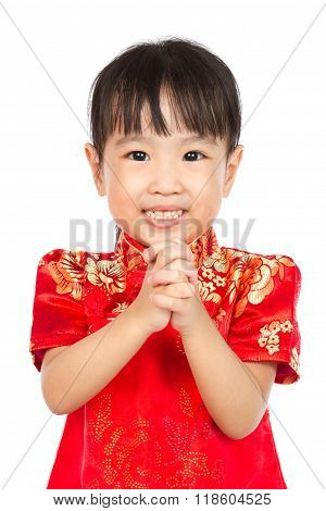Asian Little Girl Wishing You Happy Chinese New Year With Congratulation Gesture