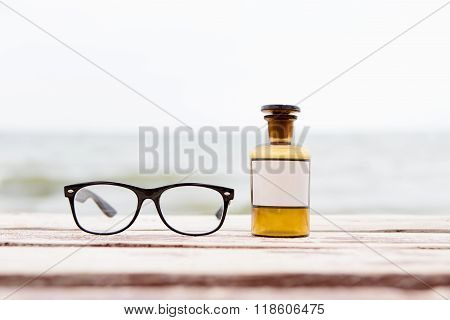 Eye Care Concept With Glasses And Medicine Bottle